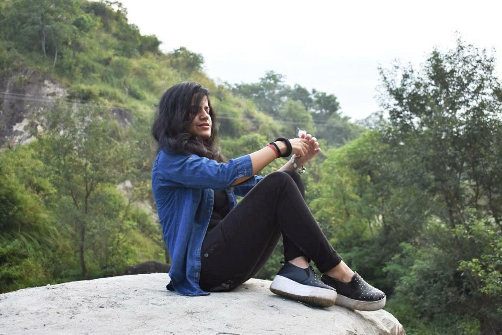 Divya sitting in hills