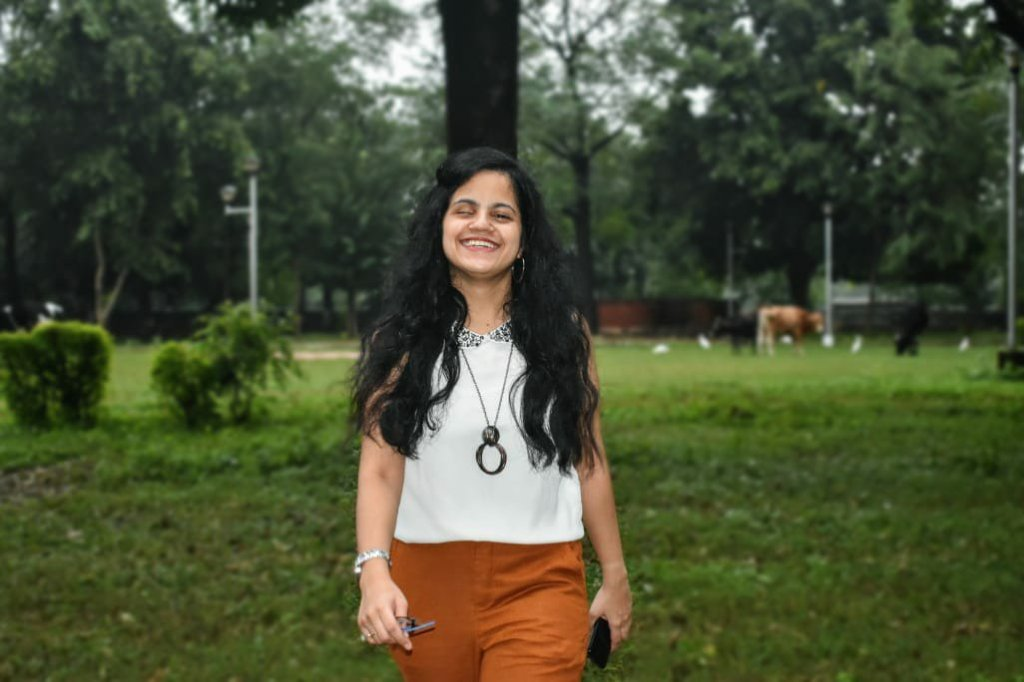 Divya standing  in the park