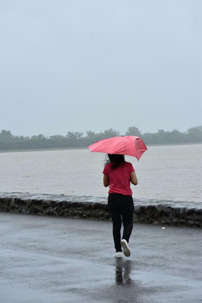 Divya walking with umbrella