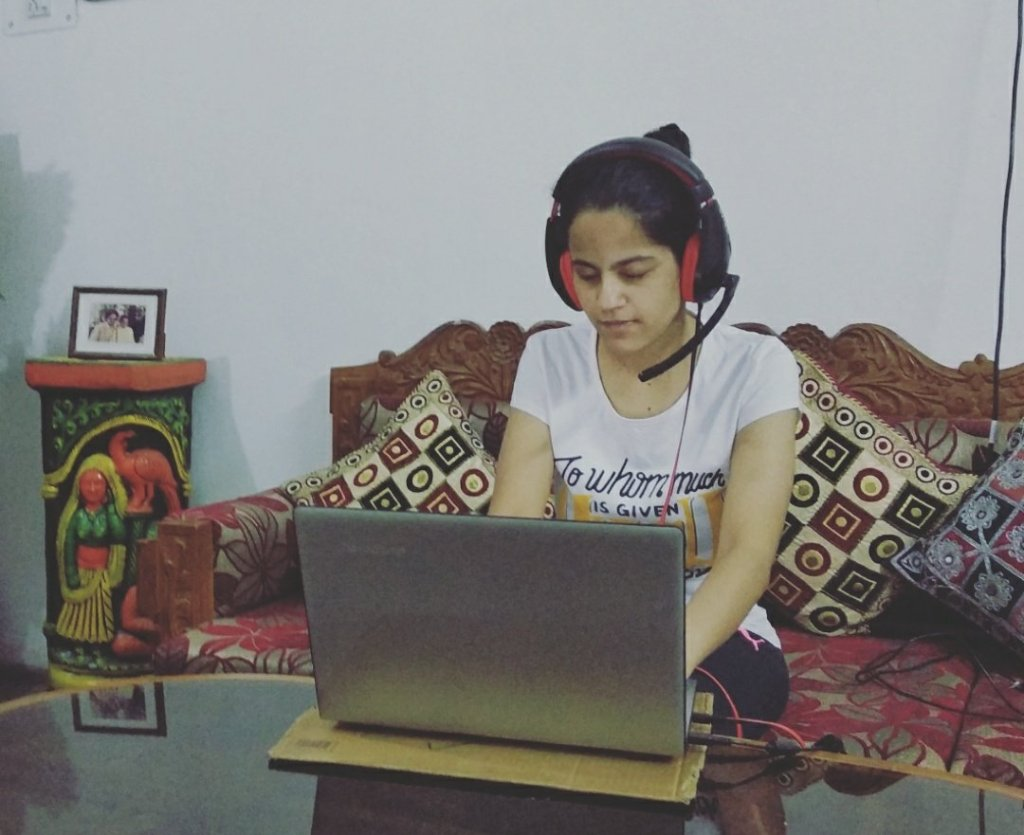 Divya working on her laptop